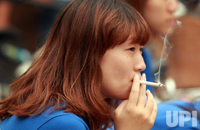 A Chinese woman smokes in Beijing