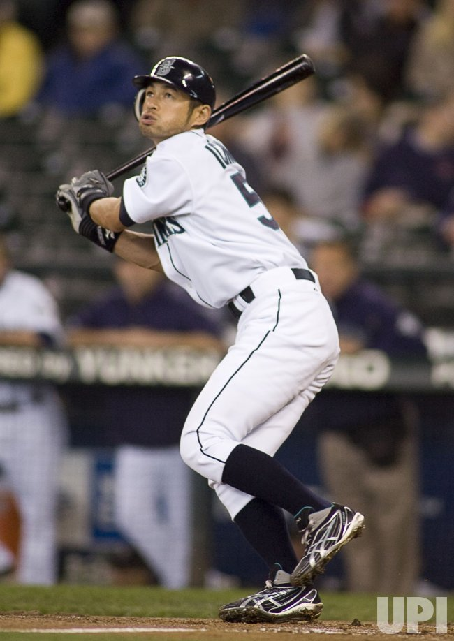 Seattle Mariners' Ichiro Suzuki watches his pop fly to left field being caught by Detroit Tigers' Brennan Biesch in the first inning.
