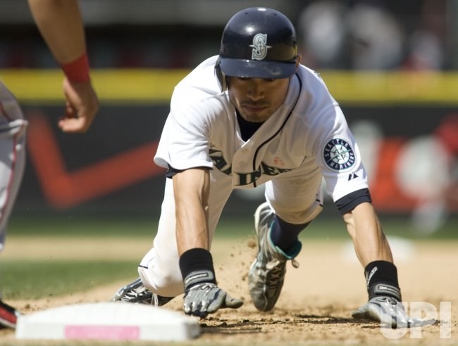 Seattle Mariners' Ichiro Suzuki dives back to first base against the Los Angeles Angels.