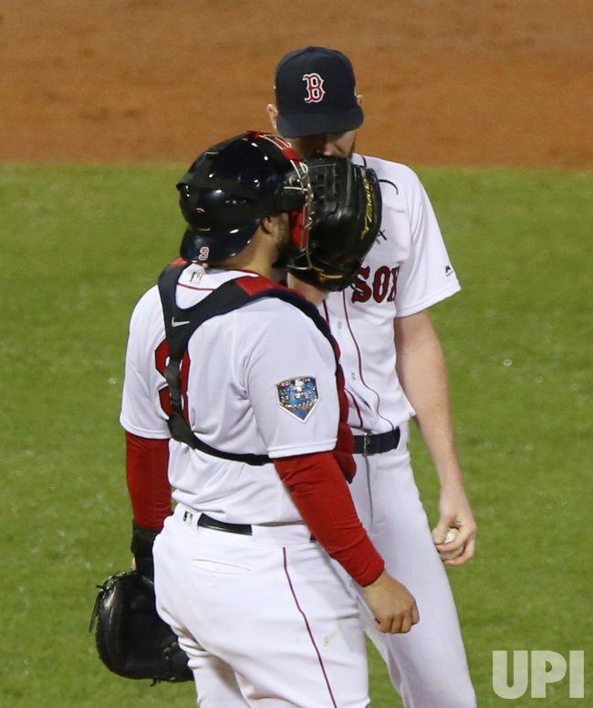 Red Sox's Chris Sale, Sandy Leon confer during World Series Game 1