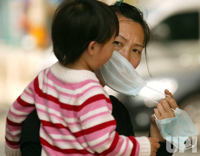 Mother wears face mask in Beijing