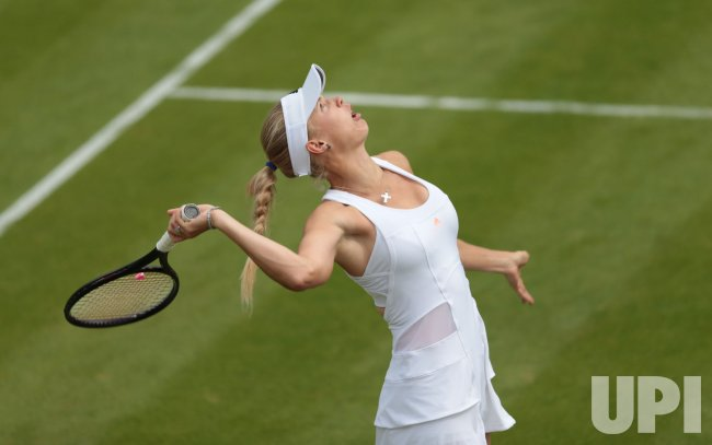 Caroline Wozniacki serves at 2013 Wimbledon Championships