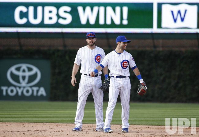Cubs Mike Freeman celebrates with Tommy La Stella after defeating Reds in Chicago