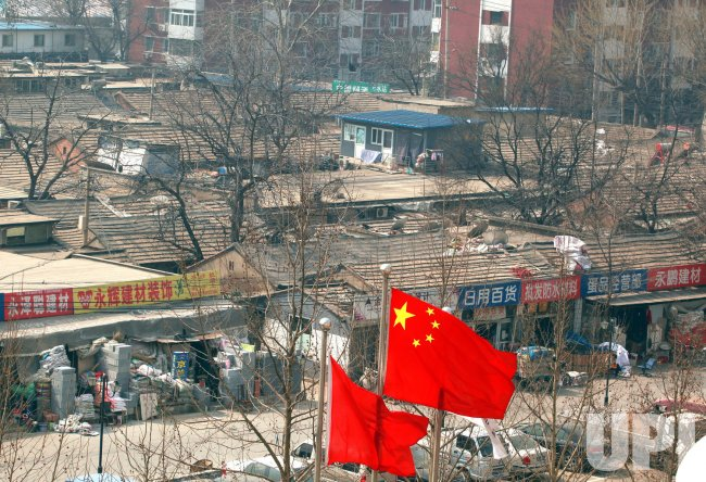 Flag flies over low-income neighborood in Beijing