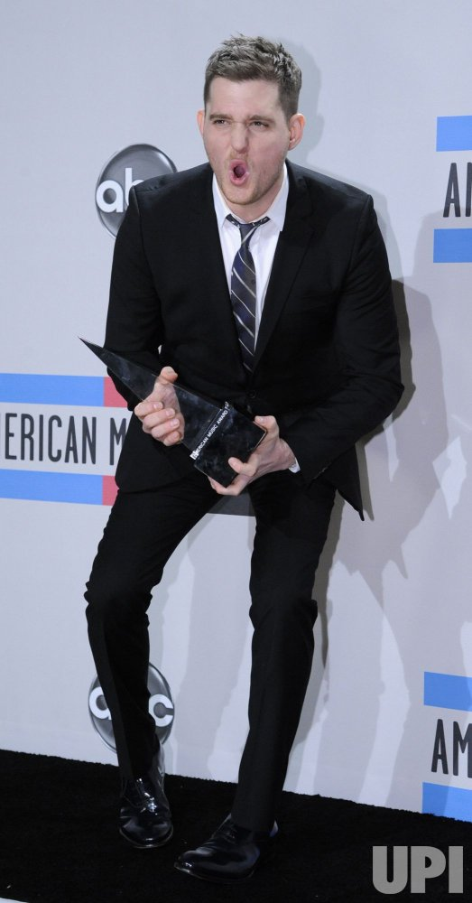 Singer Michael Buble poses backstage at the 2010 American Music Awards Los Angeles