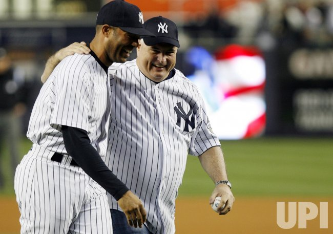 President of the Republic of Panama Ricardo Martinelli puts his arm around Mariano Rivera after throwing out the first pitch before the Boston Red Sox play New York Yankeesin New York