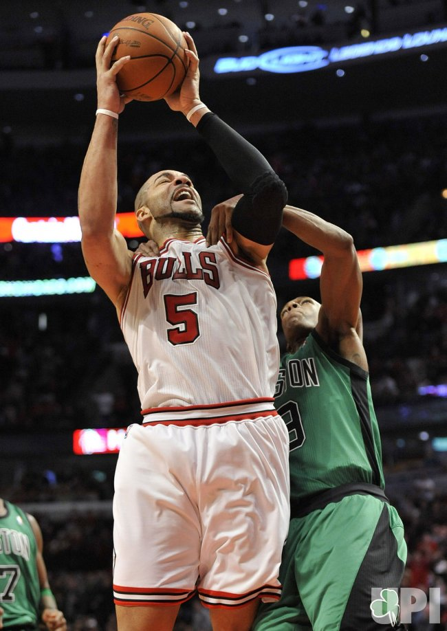 Celtics Rondo fouls Bulls Boozer in Chicago