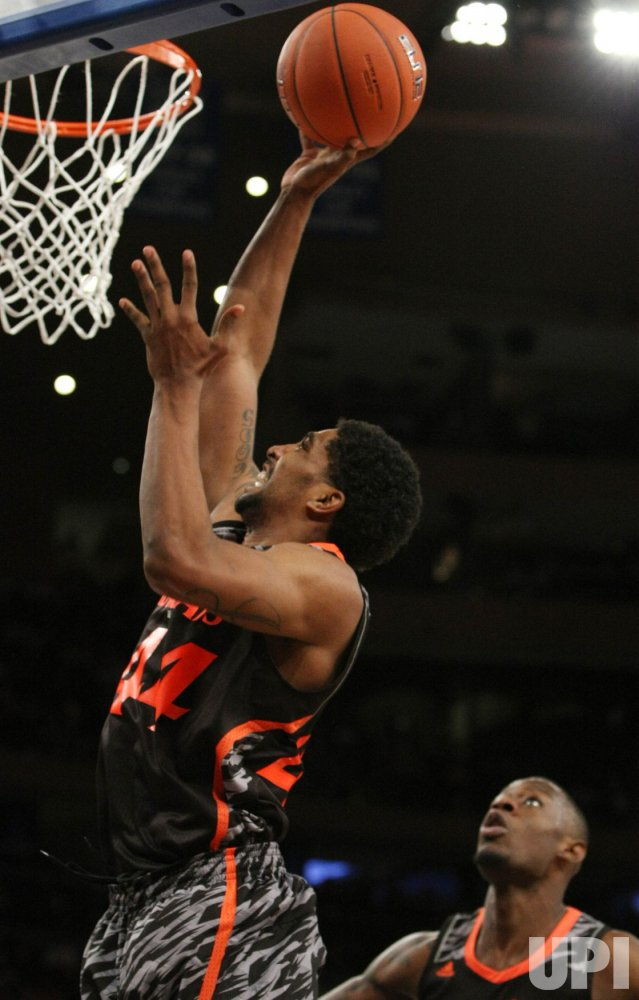 Cincinnati takes on Providence at the NCAA Big East Men's Basketball Championships in New York