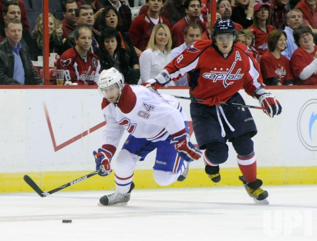Capitals Ovechkin and Canadiens Pyatt chase puck in Washington