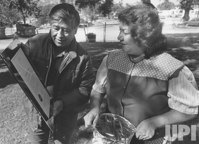 Cesar Chavez shows wife Helen a plaque from the city of Montreal