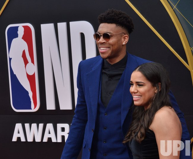 Giannis Antetokounmpo and Mariah Riddlesprigger attend the ...