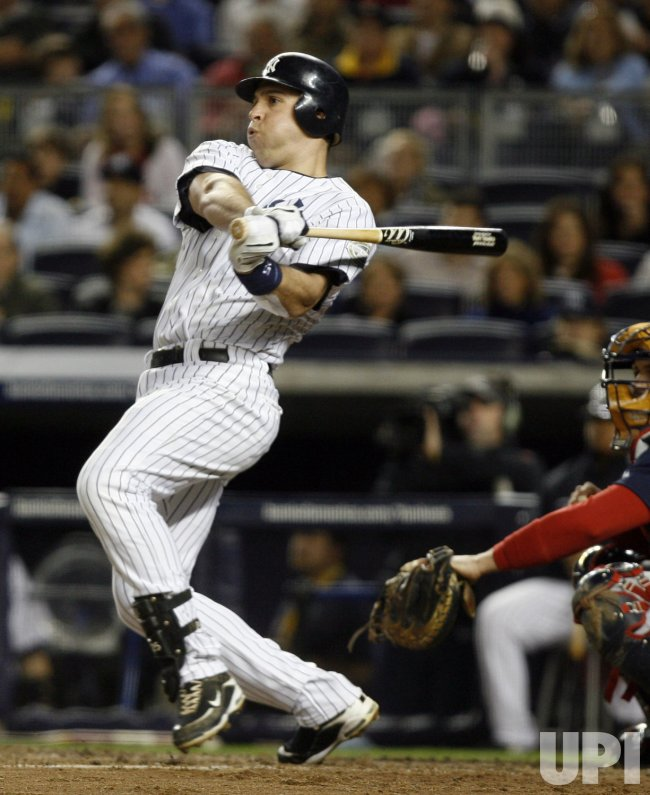 New York Yankees Mark Teixeira hits a single in the third inning against the Boston Red Sox at Yankee Stadium in New York