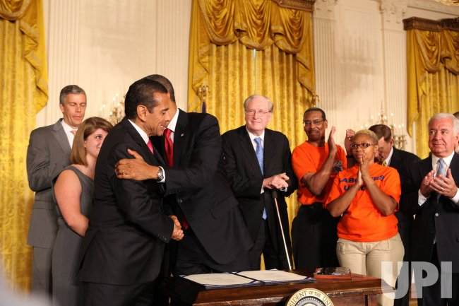 President Obama signs HR 4348 in Washington