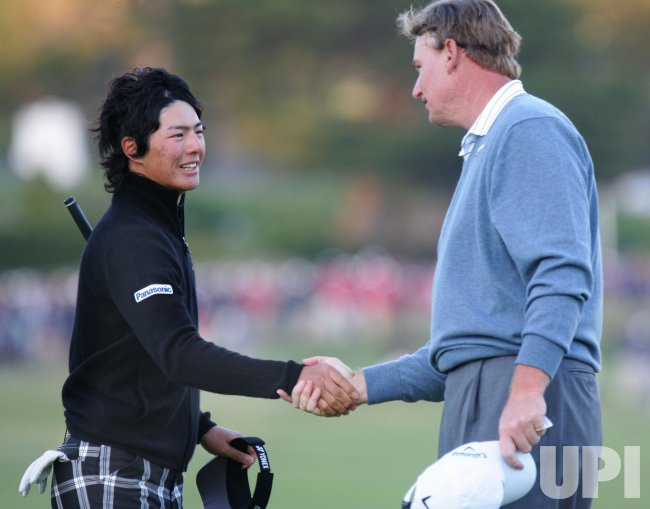 Ryo Ishikawa shakes hands with Ernie Els after playing day three of the U.S. Open in Pebble Beach, California