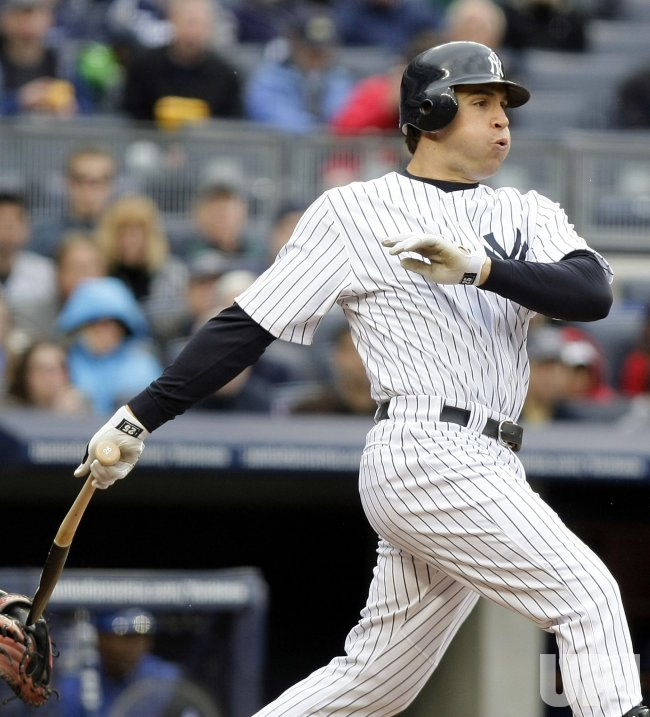 New York Yankees Mark Teixeira hits an RBI single at Yankee Stadium in New York