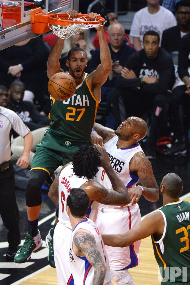 Jazz center Rudy Gobert dunks the ball in Los Angeles