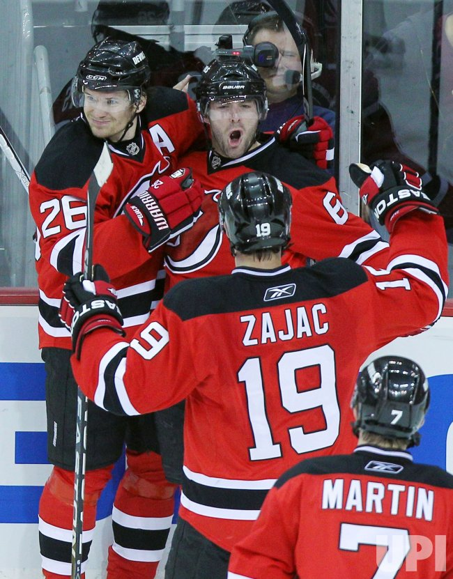 New Jersey Devils Patrik Elias (26) and Travis Zajac celebrtate Andy Greene goal at Prudential Center in New Jersey