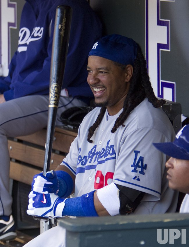 Dodgers Ramirez Laughs in Dugout in Denver