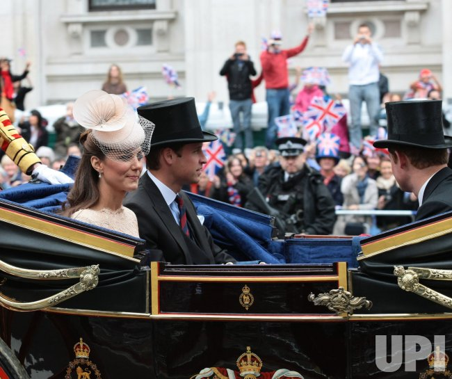 The Duke and Duchess of Cambridge ride in the Royal Diamond Jubilee procession in London