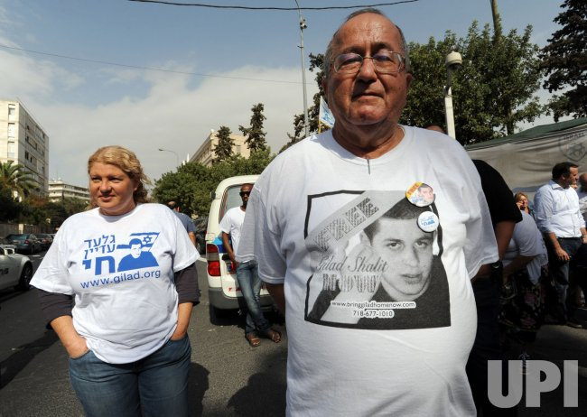 An Israeli man wears a t-shirt with a photo of captured Israeli soldier Gilad Shalit outside a protest tent in Jerusalem