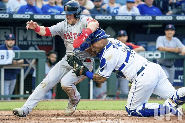 Red Sox Christian Arroyo is Tagged Out by Royals Salvador Perez