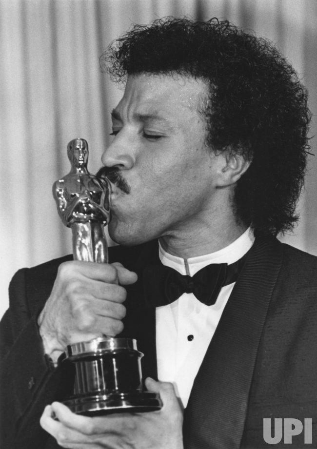 Lionel Richie kisses the Oscar he won in 1986