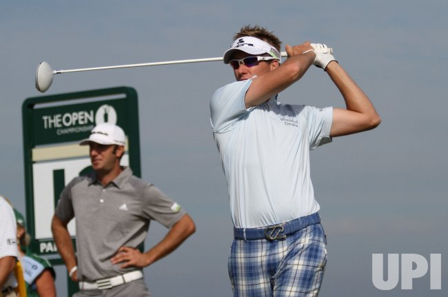 Ian Poulter tees off on the 12th hole during the Open Championship in England.
