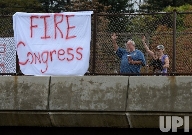 "Citizens Display ""Fire Congress"" Signs Along an Interstate Highway in Maryland"