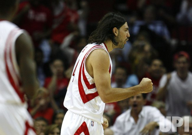 Houston Rockets Luis Scola, of Argentina, Pumps His Fist After Making a Basket and Getting Fouled at Toyota Center in Houston