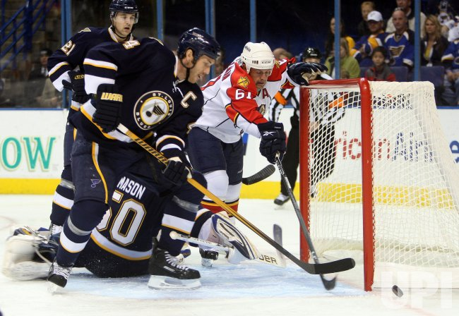 Florida Panthers Cory Stillman and St. Louis Blues Eric Brewer