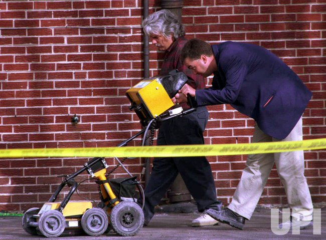 Police search a Chicago lot for evidence of mass burial by executed killer John Wayne Gacy