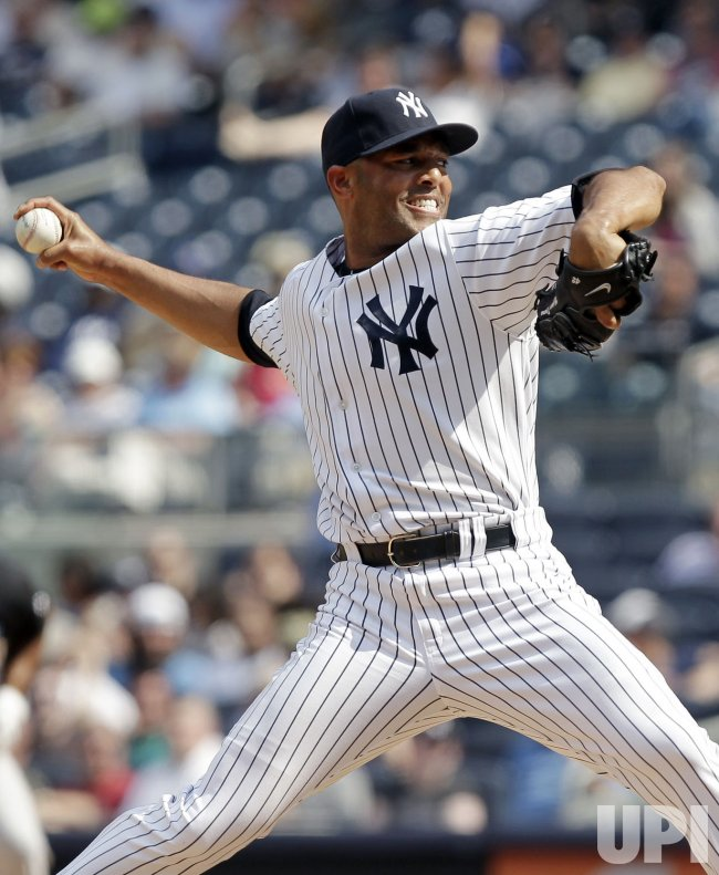 New York Yankees Mariano Rivera throws a pitch at Yankee Stadium in New York