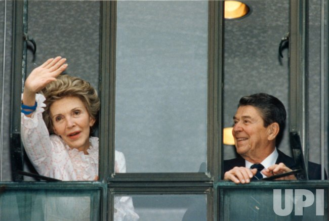 Nancy Reagan Waves from Hospital Window beside President Reagan