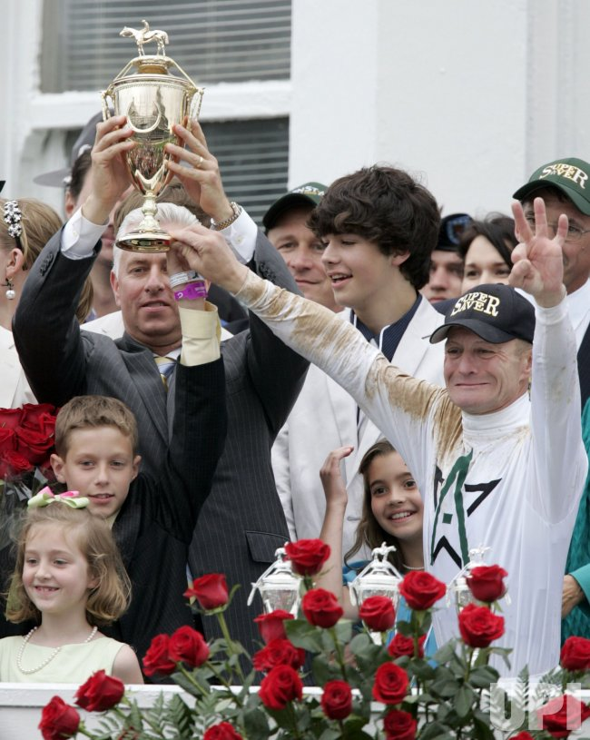 Trainer Todd Pletcher and Calvin Borel Celebrate Winning the Kentucky Derby