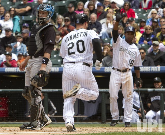 Rockies Iannetta Scores Against the Blue Jays in Denver
