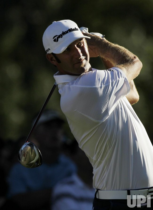 Dustin Johnson hits a tee shot at Ridgewood Country Club in New Jersey