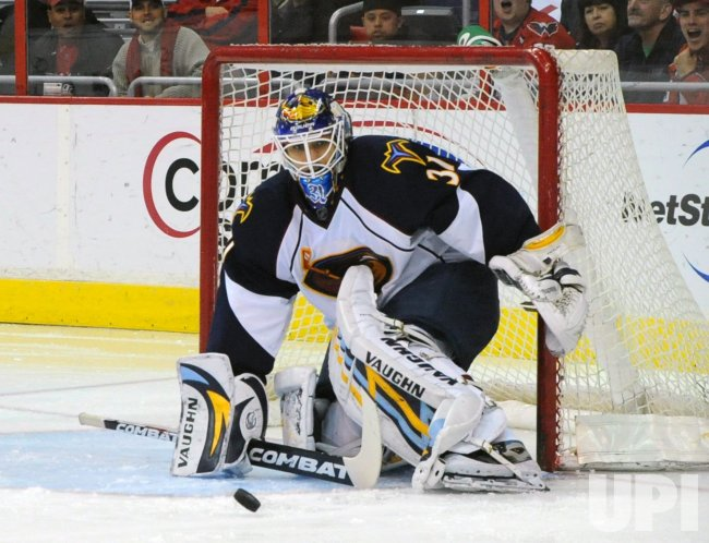 Thrashers Pavelec blocks shot from Capitals in Washington.