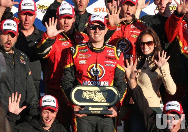 Kyle Busch celebrates winning NASCAR truck race in Louden, New Hampshire