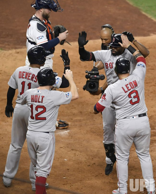Red Sox Bradley, Jr. celebrates grand slam in the eighth inning in ALCS game three
