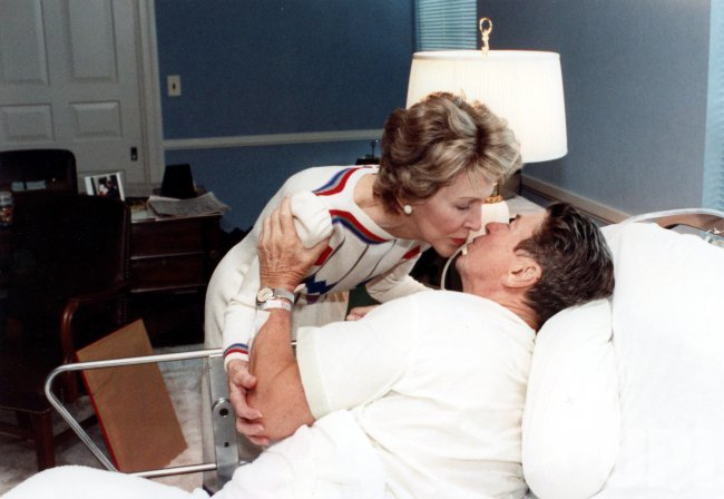 Nancy Reagan kisses her husband, Ronald Reagan.