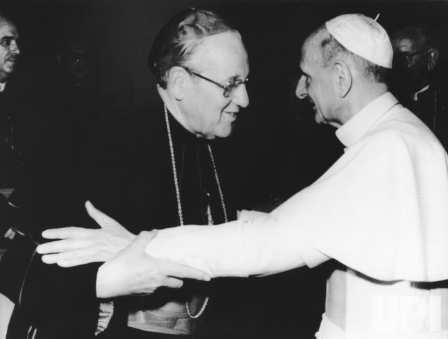 Pope Paul VI embraces Cardinal John Patrick Cody of Chicago in Vatican City