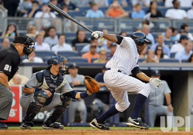 New York Yankees Curtis Granderson hits a single at Yankee Stadium in New York