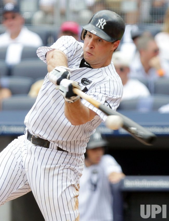 New York Yankees Mark Teixeira drives in a run with double at Yankee Stadium in New York