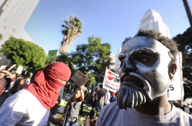 Occupy LA protesters participate in a march in Los Angeles