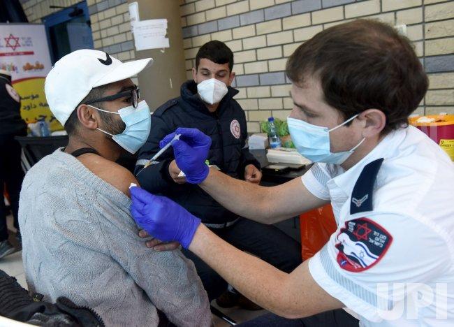 A Palestinian Receives The Pfizer-Biotech Coronavirus Vaccine At The Qalandiya Checkpoint