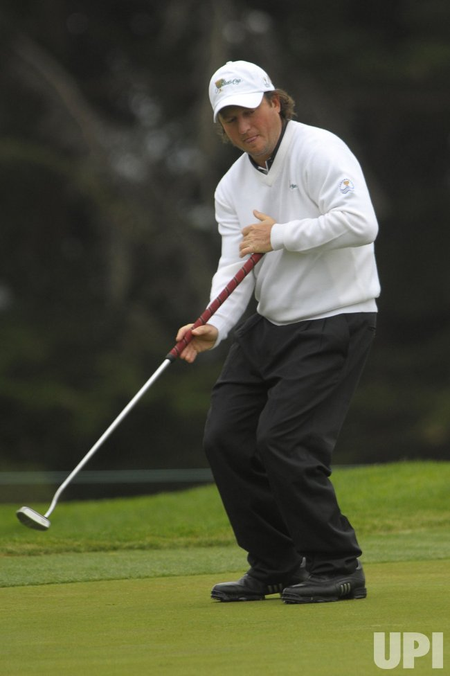 Tim Clark reacts after putting during the third round of the 2009 Presidents Cup in San Francisco