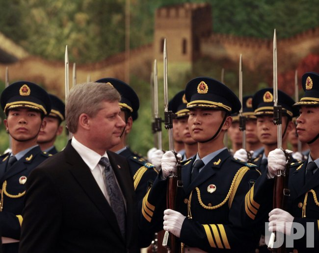 Canadian Prime Minister Harper attends a welcoming ceremony in Beijing