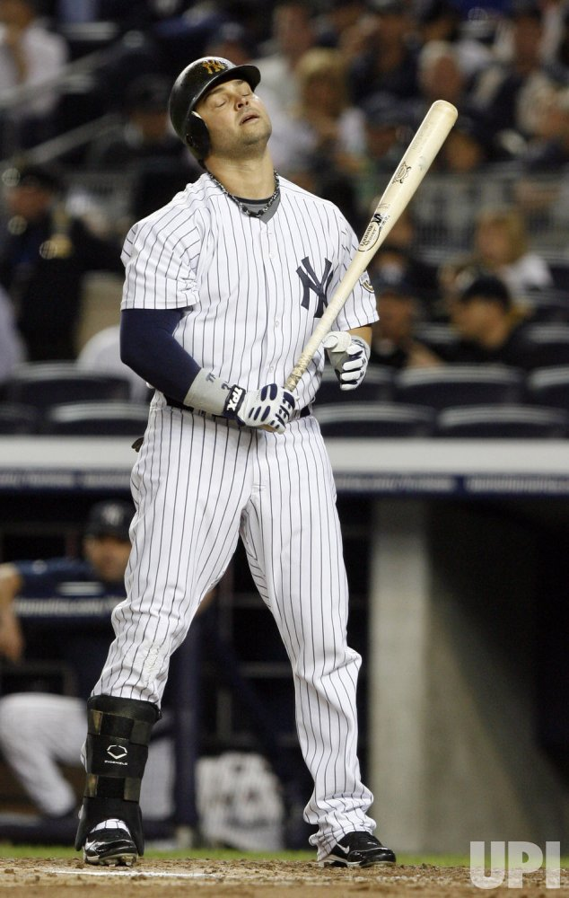New York Yankees Nick Swisher reacts after striking out in the second inning in game 2 of the ALDS against the Minnesota Twins at Yankee Stadium in New York