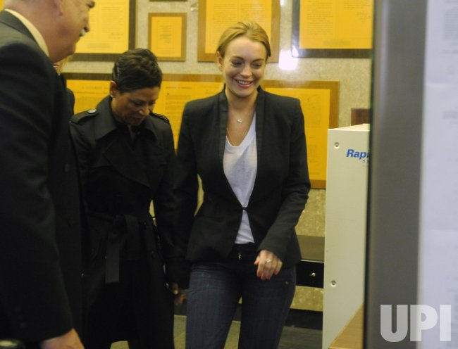 Actress Lindsay Lohan arrives at the courthouse in Beverly Hills, California
