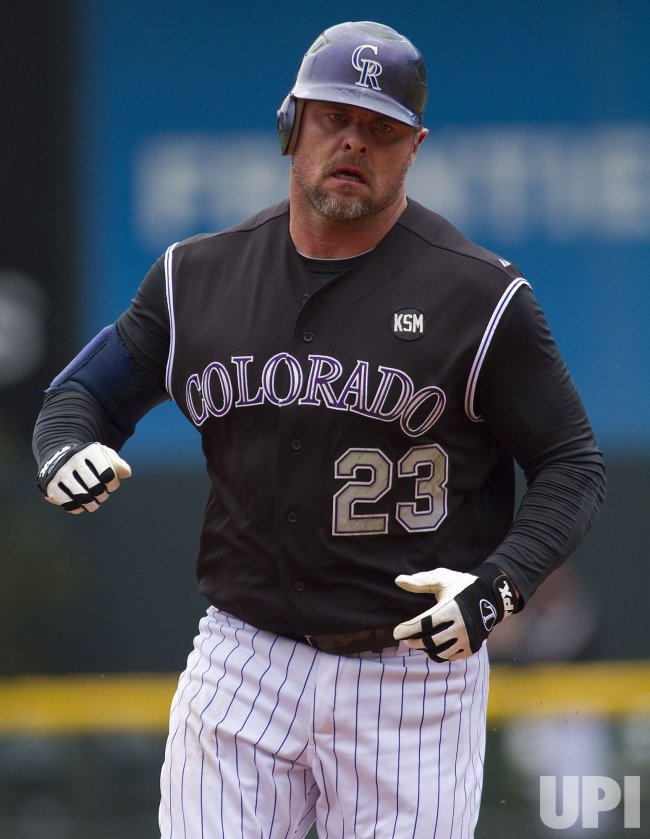 Rockies Giambi Rounds the Bases after Solo Home Run Against the Nationals in Denver